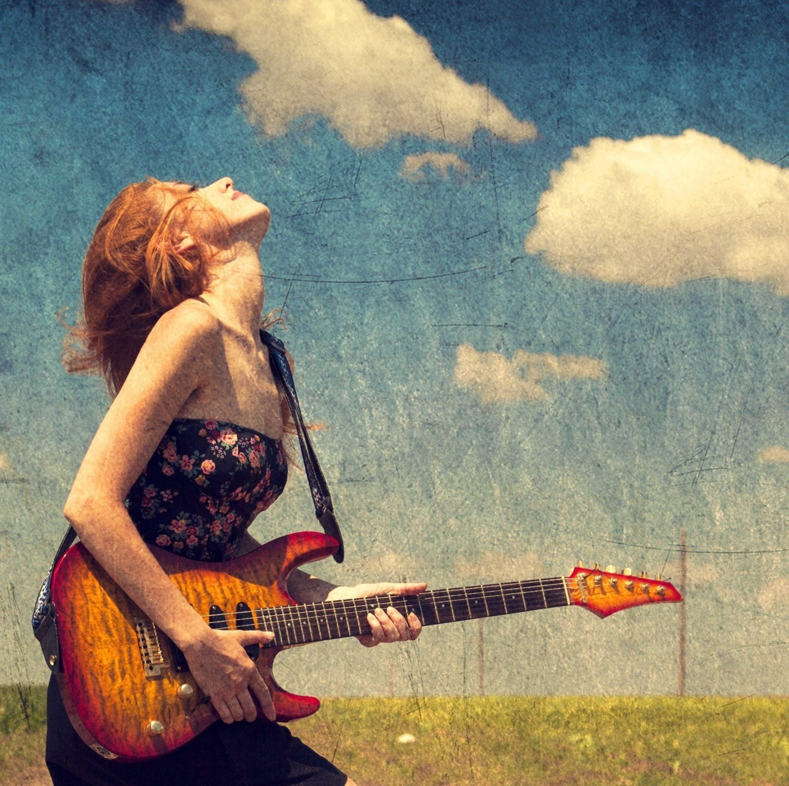 A girl is enjoying with guitar in open air